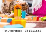 small child playing with wooden ... | Shutterstock . vector #351611663