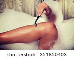 woman shaving her leg with... | Shutterstock . vector #351850403