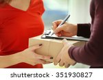 man signing receipt of delivery ... | Shutterstock . vector #351930827