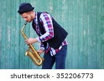 The Musician Plays Saxophone O...