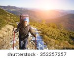 tourist with a backpack is on a ... | Shutterstock . vector #352257257