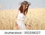 girl in field | Shutterstock . vector #352338227