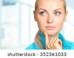 portrait of a thoughtful woman   Shutterstock . vector #352361033