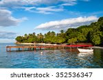 Red Pier And Boat On The Exoti...