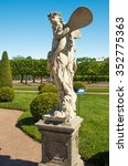 "Small photo of PETERHOF,SAINT-PETERSBURG,RUSSIA-JUNE 5, 2015: Sculpture ""Aeolus"" in the Upper Garden. Peterhof"
