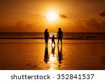 Happy Family On A Beach At...