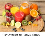 sweet juice and fruits on wood | Shutterstock . vector #352845803