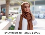 smiling girl in hijab covering... | Shutterstock . vector #353311937