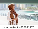 smiling girl in hijab covering... | Shutterstock . vector #353311973