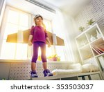 child plays in an astronaut... | Shutterstock . vector #353503037