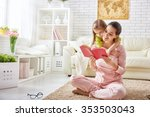 pretty young mother reading a... | Shutterstock . vector #353503043