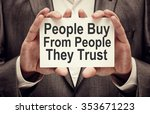 Small photo of People Buy From People They Trust. Businessman holding a card with a message text written on it