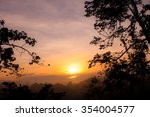 Stock photo sunrise in the forest and fog 354004577