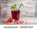 a glass of pomegranate juice... | Shutterstock . vector #354007337