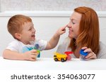 mother playing with her son | Shutterstock . vector #354063077