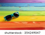 Sunglasses On A Colorful Woode...