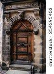 Old Wooden Door With Gargoyles...