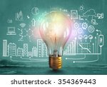 glass glowing light bulb and... | Shutterstock . vector #354369443