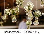 Stock photo original wedding floral decoration in the form of mini vases and bouquets of flowers hanging from 354527417