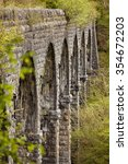 Small photo of Seven arches of Pont Sarn viaduct, opened on the 8th of August 1868 as a railway bridge, it is now part of the Taff trail long distance foot and cycle path that goes from Brecon to Cardiff.