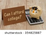 Small photo of Can I afford college, A golden with grad cap piggy bank, card and calculator on a wood background with text Can I afford College