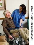 nurse with man in wheelchair - stock photo