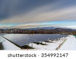 solar cell panel and village in ... | Shutterstock . vector #354992147