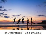 group of people jumping on the... | Shutterstock . vector #355191863