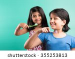 cute indian girls posing with... | Shutterstock . vector #355253813
