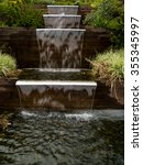 Small photo of Cascading pond in landscaped garden in Akureyri, Iceland.