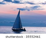 Sailboat At Sunset In The Ocea...