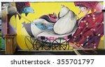 Small photo of VITRY-SUR-SEINE, FRANCE -24 DEC 2015- Street art wall mural entitled Femme au Landau (woman with stroller) by French graffiti artist Inti Ansa in Vitry.