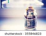 a glass jar with money is... | Shutterstock . vector #355846823