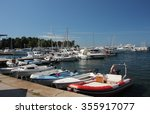 Motor Boats And Sailboats In...