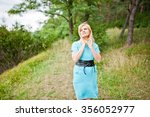 adult blonde woman posed at... | Shutterstock . vector #356052977