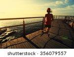 young fitness woman runner... | Shutterstock . vector #356079557