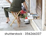 Woman Artist Painting On The...