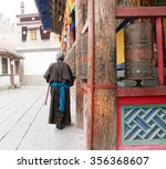 one female tibetan prays at... | Shutterstock . vector #356368607