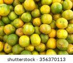 oranges and mandarin in a bucket | Shutterstock . vector #356370113