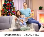 happy family on sofa in the... | Shutterstock . vector #356427467