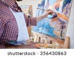 Hand of artist painting italian ...