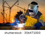 Welder Working A Welding Metal...