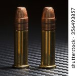 Small photo of Two cartridges that are designed for twenty two rimfire firearms