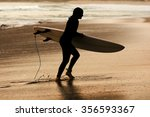 surfer in  beach  at sunset | Shutterstock . vector #356593367
