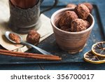Small photo of Raw chocolate candy with nuts, figs and citrus, truffle, healthy dessert,selective focus