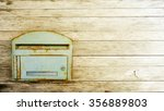 Postbox On The Wood Background