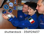 Small photo of MOSCOW, RUSSIA - NOVEMBER 11, 2014: ISS Expedition 42/43 crewmembers T.Virts (left), S.Cristoforetti (center) and A.Shkaplerov (right) affix a decal aboard aircraft on the way to Baikonur cosmodrome