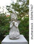 Stone Sculpture Of A Little...