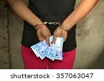 female thief cuffed hands with... | Shutterstock . vector #357063047