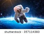 astronaut over earth   elements ... | Shutterstock . vector #357114383